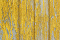 Wall of old wooden house with old paint ochre. Peeling paint reveals the wood texture Royalty Free Stock Photo