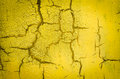 Wall painted in yellow cracked abstract background Royalty Free Stock Photos