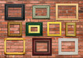 Wall and picture frames contemporary on a brick Royalty Free Stock Photos