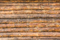 Wall of raw logs texture close up horizontal traditional country house construction wooden architecture Royalty Free Stock Photography