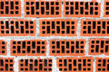 Wall of red bricks with cement background Stock Images