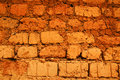 Wall of red earth bricks Royalty Free Stock Photos