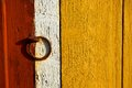 Wall with ring rusty iron on old barn yellow wooden door Royalty Free Stock Images