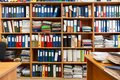 Wall from shelves with colourful file binders, an office room with papers and documents Royalty Free Stock Photo