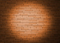 Wall with spotlight orange brick Royalty Free Stock Image