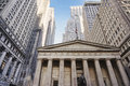 Wall street architecture new york city federal national hall memorial with its george washington statue and the stock exchange Royalty Free Stock Image