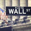 Wall street street sign with the New York Stock Exchange on the Royalty Free Stock Photo