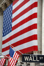 Wall Street, street sign, with US flag Royalty Free Stock Images