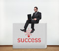 Wall with success businessman sitting on concrete Royalty Free Stock Image