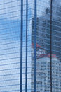 Wall of tall building or blue glass of skyscraper background. Royalty Free Stock Photo