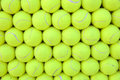 Wall of tennis balls aligned - background Royalty Free Stock Photo
