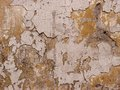 A wall texture light brown white yellow cracked Stock Photo