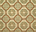 Wall tiled with green brown circular floral ceramic tiles