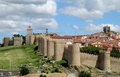 Wall tower and bastion of avila spain made of yellow stone bricks medival ancient city battlements castle walls around the modern Royalty Free Stock Photos