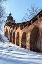 The wall and tower of the nizhny novgorod kremlin clock in sunny winter day Stock Image