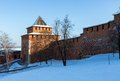 The wall and tower of the nizhny novgorod kremlin gate in sunny winter day in september through this minin Stock Photos
