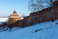 The wall and tower of the nizhny novgorod kremlin gate in sunny winter day in september through this minin Royalty Free Stock Image
