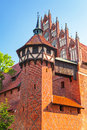 The wall and towers of malbork castle in summer scenery poland Royalty Free Stock Image