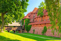 The wall and towers of malbork castle in summer scenery poland Royalty Free Stock Photo