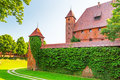The wall and towers of malbork castle in summer scenery poland Stock Images