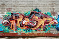 A wall vandalized with street graffiti art Royalty Free Stock Photo