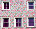 Wall and windows: pink, purple and flowers! Stock Image