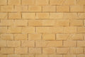 Wall of yellow brickwork background Royalty Free Stock Photo