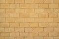 Wall of yellow brickwork background Royalty Free Stock Photo