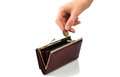 Wallet and coin an empty purse a hand holding a against white background Stock Photography