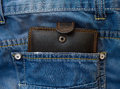 Wallet in a jeans pocket dark blue with black Royalty Free Stock Photo