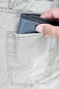 Wallet in jeans pocket hand with Stock Photography