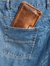 Wallet in pocket brown jeans trousers back Royalty Free Stock Image
