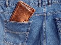 Wallet in pocket brown jeans trousers back Royalty Free Stock Photography