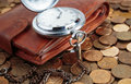 Wallet and pocket watch on the coins background Royalty Free Stock Photography