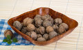 Wallnut in the basket on wooden background Stock Photo