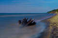 Wallpaper - The beach with a stump in long exposure Royalty Free Stock Photo