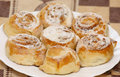 Walnut buns with powdered sugar on plate Royalty Free Stock Photo