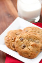 Walnut and chocolate chip cookies oven fresh home made with a glass of milk Royalty Free Stock Photography