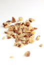 Walnut crumbs bunch of on white background Royalty Free Stock Images
