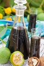 Walnut liqueur with green walnuts Royalty Free Stock Photo
