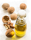Walnut oil in a bottle on marble Royalty Free Stock Photo