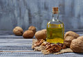 Walnut oil in bottle and nuts Royalty Free Stock Photo