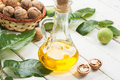 Walnut oil in bottle on white wooden background selective focus Royalty Free Stock Photography