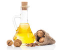 Walnut oil in a glass transparent bottle Royalty Free Stock Photo