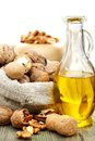 Walnut oil  and nuts in a bag. Royalty Free Stock Photo