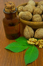 Walnut oil and nuts on wooden table Royalty Free Stock Photo