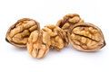 Walnut and walnut kernel isolated on the white background. Royalty Free Stock Photo