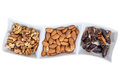 Walnuts almonds and dates in a white dish Royalty Free Stock Photo