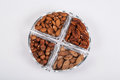 Walnuts and almonds in a glass dish Royalty Free Stock Photo