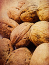 Walnuts background close up of scattered whole on grunge paper Royalty Free Stock Photography